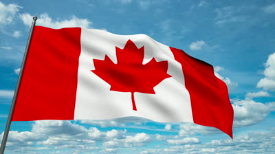 stock-footage-canada-flag-waving-against-time-lapse-clouds-background